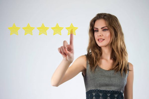 Review, increase rating or ranking, evaluation and classification concept. Businessman draw five yellow star to increase rating of his company.